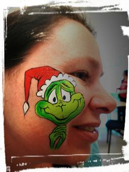 Dr. Seuss face painting, Cheek Art, Cheek face painting, The Grinch face painting, Christmas face painting